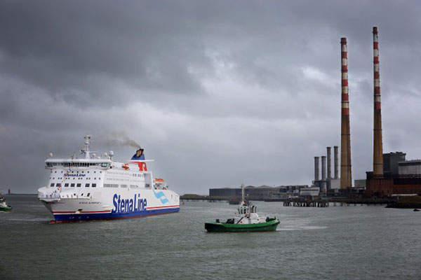 A geologist collecting iron ore from Brazil's Minas-Rio project.