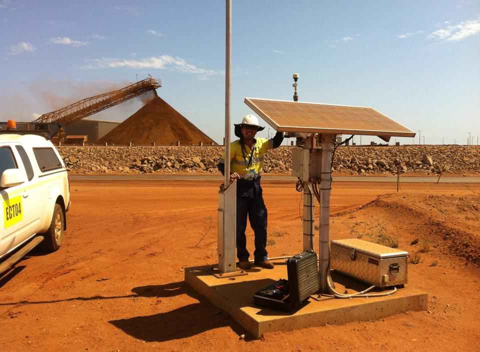 Solar-powered particulate monitor in Port Hedland, Western Australia. ECOTECH Technical Support Specialist, Nuno Rodrigues, performing site maintenance.
