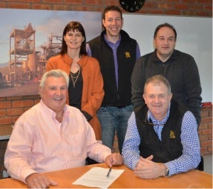 Randy Agius and Sandy Gray (seated) sign the agreement with Elizabeth Lewis-Gray, Adam Hesse and Nick Katsikaros.