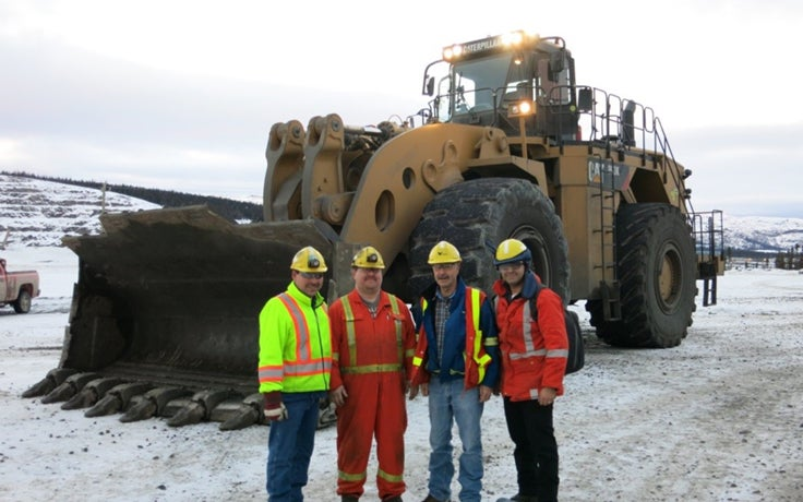 LoaderMetrics product manager Saeed (far right) with the helpful staff at Voisey's Bay.