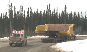Off-highway truck body for hauling oil sands