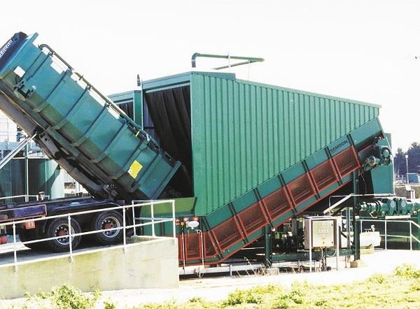 Samson® Material Feeder taking over bulk materials from truck.