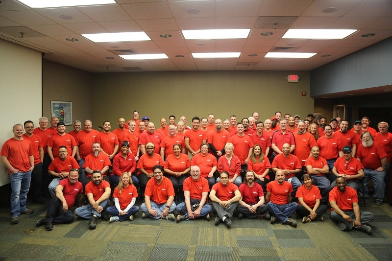 "Employees at Flexco's Downers Grove, Ill. headquarters took a group photo and later sang ""Happy Birthday"" to Flexco."