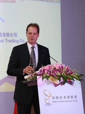 Verder Liquids director John Hoorneman receiving the Ringier Technology Innovation Award.